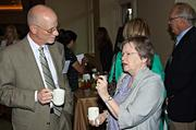 Ken Binder listens intently to Sr. Maryadele Robinson, both from Catholic Charities as they have coffee during the social hour at the Mass High Tech & Boston Business Journal's 2013 CIO of the Year awards breakfast.