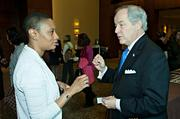 LaNitra S. Webb of Commodore Builders and John M. Harrington, III of the Sheffield Corporation talk business during the morning coffee hour at the Mass High Tech Women To Watch awards breakfast held at the Westin Waterfront Hotel in Boston.