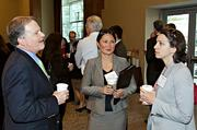 Berkshire Bank's Ken Cheo and Yuki Cohen visit with Aybike Doganci Crott of Solectria Renewables at the morning coffee hour at the Mass High Tech Women To Watch awards breakfast.