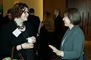 Having a lighter moment at the morning coffee hour at the Mass High Tech Women To Watch awards breakfast were Bobbie Carlton of Carlton PR & Marketing and Nancy Saucier of UMass Lowell.