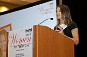 Mary-Alice Brady, CEO of MosaicHub accepts her award at the 2013 Mass High Tech Women To Watch awards breakfast.