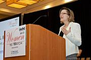 Suzanne L. Bruhn, Ph.D., president and CEO of Promedior accepts her award at the 2013 Mass High Tech Women To Watch awards breakfast.