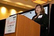 Sheila DeWitt, Ph.D., president and CEO of Deute℞ accepts her award at the 2013 Mass High Tech Women To Watch awards breakfast.