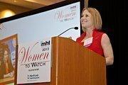 Lital Asher-Dotan, open innovation manager, global business development at P&G accepts her award at the 2013 Mass High Tech Women To Watch awards breakfast.