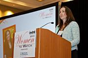 Joanna Dowling, director, president and CEO of Custom Group Manufacturing Technology accepts her award at the 2013 Mass High Tech Women To Watch awards breakfast.