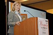 Angelika Fretzen, vp of pharmaceutical chemistry and development at Ironwood Pharmaceuticals accepts her award at the 2013 Mass High Tech Women To Watch awards breakfast.