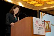 Anne-Laure Grillot, Ph.D., research fellow II, chemistry at Vertex Pharmaceuticals accepts her award at the 2013 Mass High Tech Women To Watch awards breakfast.