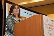 Leslie Jelalian, vp of intelligence, reconnaissance and surveillance at BAE Systems accepts her award at the 2013 Mass High Tech Women To Watch awards breakfast.
