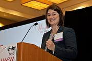 Wendy Pryce Lewis, head of R&D at Cabot Aerogel, Cabot Corporation accepts her award at the 2013 Mass High Tech Women To Watch awards breakfast.