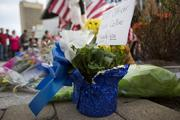 A note thanking MIT Officer Sean Collier sits at a make shift memorial at the site where Collier was shot and killed by the alleged Boston Marathon bombers.