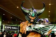Offering what appears to be a less than friendly greeting at the entrance of the Boston Convention & Exhibition Center to attendees of the PAX East 2013 gaming show was this likeness of Tryndamere, the Barbarian King from Wiki's League of Legends. How would you like to date his sister?