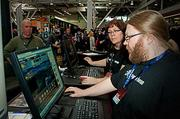 Disruptor Beam's CEO Jon Radoff and Katie Postma, community director work on getting their game, Game of Thrones up and running to display at the PAX East2013.