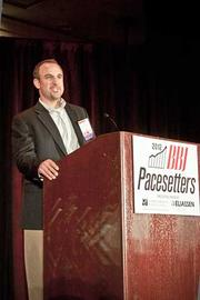 Brian Lee of Travelers Marketing accepts their Pacesetters award at the Boston Business Journal's 2012 Pacesetters Awards Breakfast.