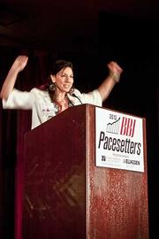 Susan Leger-Ferraro, president and founder of Little Sprouts gives an enthusiastic acceptance speech for her Pacesetters award at the Boston Business Journal's 2012 Pacesetters Awards Breakfast.