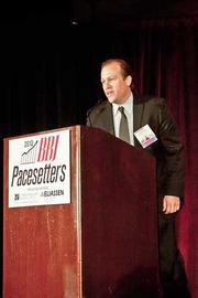 Saul Howerton of High Street Partners accepts their Pacesetters award at the Boston Business Journal's 2012 Pacesetters Awards Breakfast.