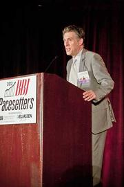 Brad Mayo of The Training Associates accepts their Pacesetters award at the Boston Business Journal's 2012 Pacesetters Awards Breakfast.