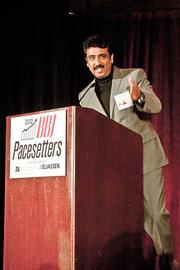 Girish Manvani of eClinical Works accepts their Pacesetters award at the Boston Business Journal's 2012 Pacesetters Awards Breakfast.