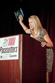 Christie Bellany of Big Night Entertainment Group accepts their Pacesetters award at the Boston Business Journal's 2012 Pacesetters Awards Breakfast.
