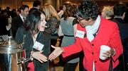Jeanine Hamilton of Hire Partnership and Annis Gill-Miller of Salem Five experience the benefit of networking over coffee at the Boston Business Journal's 2012 Pacesetters Awards Breakfast.