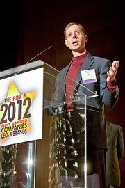 """Medium-sized company: Rapid7. CEO Mike Tuchen accepts a """"Most Admired"""" award in the startups category, in February."""