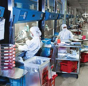 Photo of workers in a Genzyme lab.