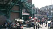 As part of the renovated entrances announced in 2004, Fenway's Gate E became a grand entrance, with concessions opening onto a Lansdowne Street that would be spruced up with cherry trees and historic street lights.