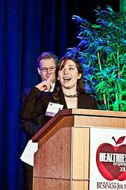 Clare Densmore, communications manager at Massachusetts Hospital Association, accepts their award in the small company category at the Boston Business Journals Healthiest Employers awards breakfast.