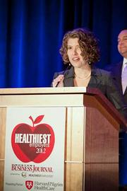 Debbie Gordon, vice president and chief marketing officer at Network Health, accepts their award in the medium company category at the Boston Business Journals Healthiest Employers awards breakfast.