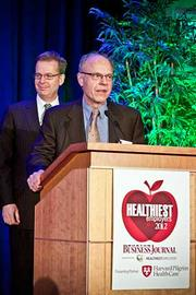 Edward Saras, senior vice president compensation, benefits and payroll at Eastern Bank, accepts their runner up award in the large company category at the Boston Business Journals Healthiest Employers awards breakfast.
