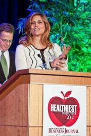 Samyra Million, CEO of Millennium Partners Sports Club Management/Sports Club LA accepts their runner up award in the medium company category at the Boston Business Journals Healthiest Employers awards breakfast.