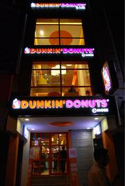 The exterior at a Dunkin' Donuts in India, one of two Dunkin' Brands has opened there.