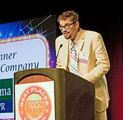 Ed Harrison of fama PR acknowledges his company's first place award in the small company division at the 2011 Boston Business Journal's Best Places To Work, held Thursday morning at the Boston Convention & Exhibition Center.