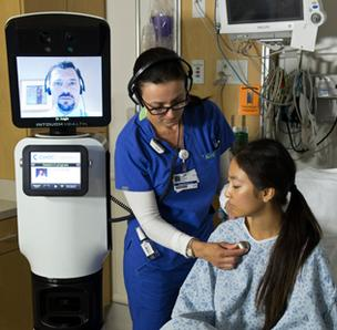 iRobot health care robot, RP VITA, with nurse and patient