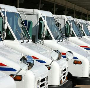 Photo of U.S. Postal Service trucks.