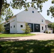 When you're tired of golf, exercise the horses. The 28-acre Blue Heron Farm includes a horse barn ...