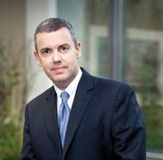 Fast-growing Rockland Trust ranked the sixth-largest bank in Massachusetts by assets, and the second largest to not demand a fee of its checking account customers. Denis Sheahan (above) is CFO.