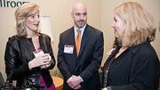 Sandy Lish of The Castle Group with her husband David MacKinnon of Eastern Bank met up with Susan Rittscher of CWE at the Boston Business Journal's 2012 Advancing Women program.