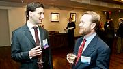 Boston Business Journal Forty Under Forty honoree Tom Brown talks with fellow Fish & Richardson co-worker Adam Kessel.
