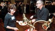 Wentworth Intstitute of Technology's Debbie Hunt is served by Frank Nagorka at the Boston Business Journal Forty Under Forty event.