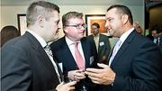 A.J. Gerristson of 451 Marketing, Michael Lonergan, Ireland Consul General to Boston, and Boston Business Journal publisher Christopher McIntosh converse at the BBJ's Forty Under Forty event.