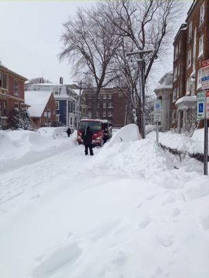 The packed snow made the roads slippery for all vehicles Saturday. Above, a stuck truck in Cambridge.