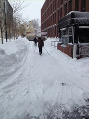 With the roads still a mess as of Saturday afternoon, Cambridge residents broke out the skis to get around town.