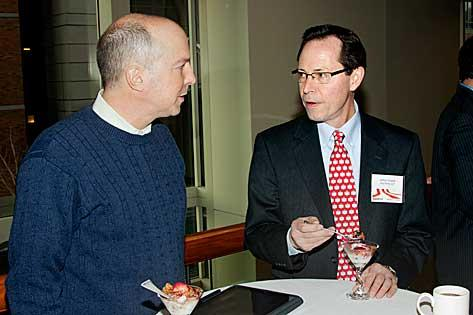 Mark Vitt  of Tritech Communications and Jeffrey Clopeck of Day Pitney in discussion during the social hour preceding the panel discussions at the Massachusetts Business Climate Summit sponsored by the Boston Business Journal and State House News Service.