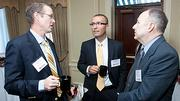 Conversing over coffee at the Boston Business Journals 2011 Champions in Healthcare awards breakfast was from left: Daniel Head of Brown Brothers Harriman & Co., Juan Lopera of Tufts Health Plan and Kim David Markert of Shepley Bulfinch.