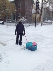 A Cambridge man and his toddler make lemonade out of lemons, charting the streets in a makeshift sled.