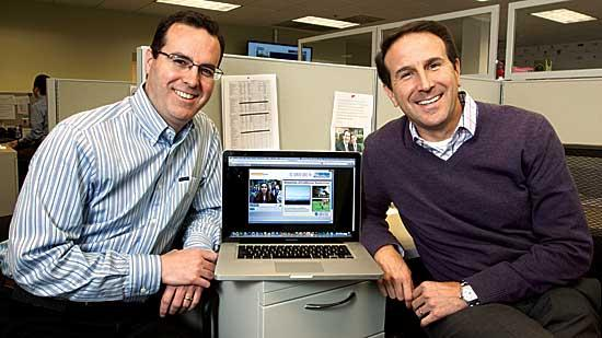 Chris Charron and Robert Rosenbloom showcasing the online interface for CollegeWeek Live, which offers an interactive forum for students and college admission officials.