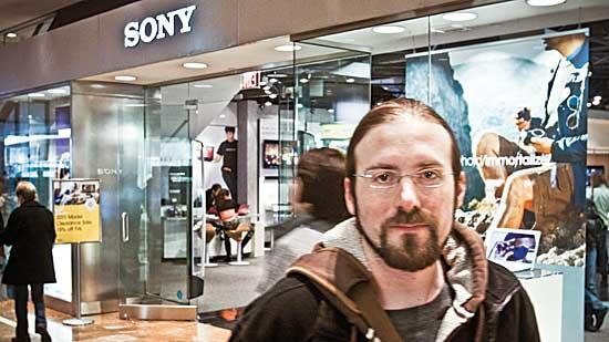 Daryl Bridges, who holds a master's degree from Boston University, works part time selling electronics at the Copley Place mall to supplement his income.