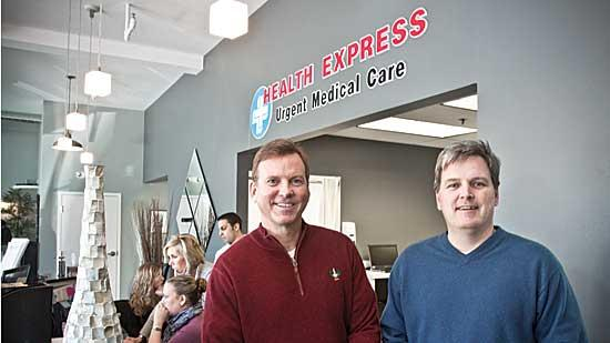 Dr. Michael Hughes and Dr. Chris Whelan in their soon to open Health Express in Weymouth. Proponents of such centers say they cut costs by diverting non-urgent care from emergency rooms.