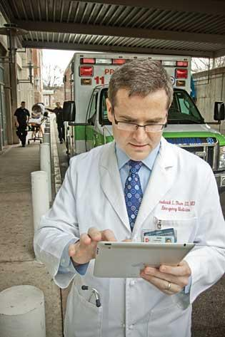 Dr. Frederick L. Thum, emergency medicine physician at Cambridge Hospital, is a fan of the Apple iPad.