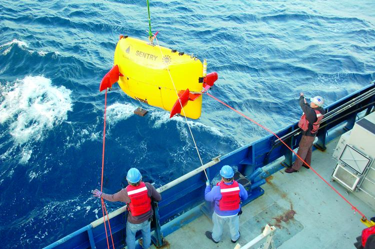 The R/V Atlantis, a ship operated by Woods Hole Oceanographic Institution, launch an underwater robot known as a Sentry during a cruise to study natural oil and methane seeps at a site about a mile off the coast of Santa Barbara, Calif.